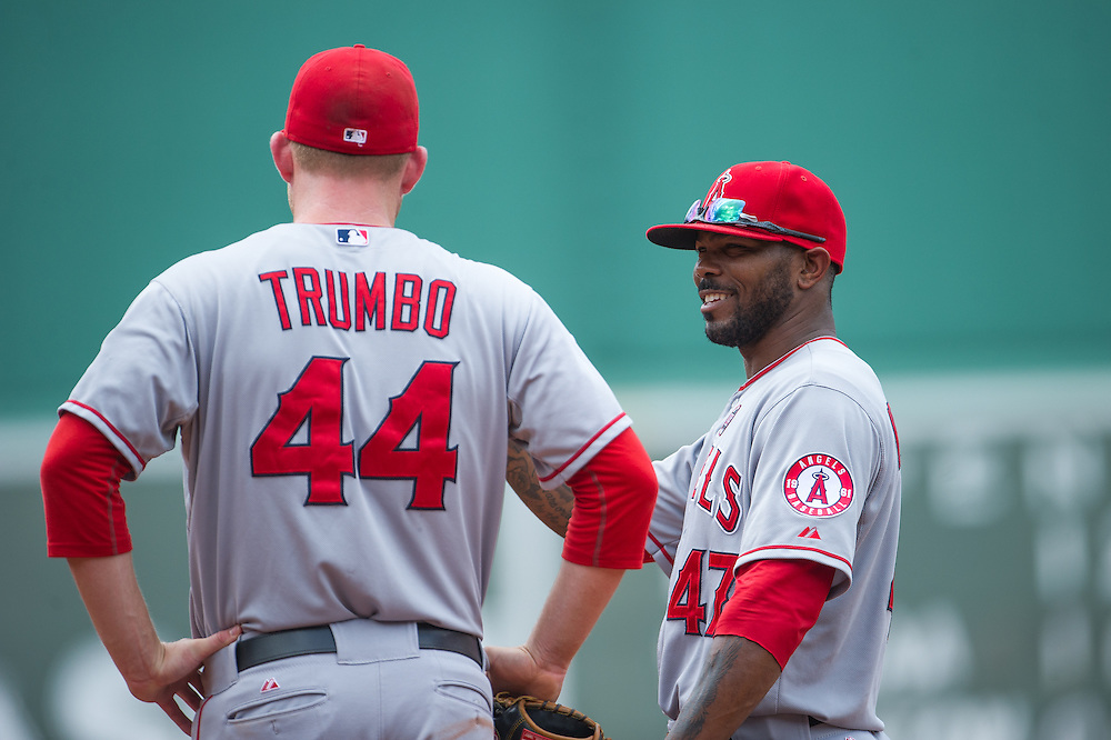 BOSTON, MA - JUNE 09: Mark Trumbo #44 and Howie Kendrick #47 of the Los Angeles Angels look on during the game against the Boston Red Sox at Fenway Park in Boston, Massachusetts on June 9, 2013. (Photo by Rob Tringali) *** Local Caption *** Mark Trumbo;Howie Kendrick