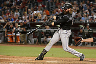 Apr 28, 2017; Phoenix, AZ, USA; Colorado Rockies outfielder Charlie Blackmon (19) singles to left driving in a run during the seventh inning against the Arizona Diamondbacks at Chase Field. Mandatory Credit: Jennifer Stewart-USA TODAY Sports
