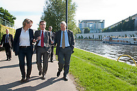03 SEP 2010, BERLIN/GERMANY:<br /> Birgit Marschall (L), Redakteurin Rheinische Post, Thomas de Maiziere (M), CDU, Bundesinnenminister, und Dr. Gregor Mayntz (R), Redakteur Rheinische Post, Intervirew waehrend einem Spaziergang von der Bundespressekonferenz zum Bundesinnenministerium, im Hintergrund: das Bundeskanzleramt<br /> IMAGE: 20100903-01-033<br /> KEYWORDS: Thomas de Maizière