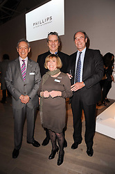 Left to right,  DR ADRIAN WHITESON Life president of the Teenage Cancer Trust MYRNA WHITESON Life president of the Teenage Cancer Trust, SIMON DAVIES CEO Teenage Cancer Trust and DAVID HOARE Chairman of the Teenage Cancer Trust at the Polo Jeans Co. hosted Art Stars Auction in support of the Teenage Cancer Trust held at Phillips de Pury & Co, Howick Place, London on 6th December 2010.