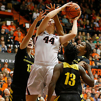 Oregon State's Ruth Hamblin, center, is fouled while going to the basket past Oregon's Jacinta Vandenberg, left, Mar'Shay (cq) Moore in the second half of an NCAA college basketball game against Oregon, in Corvallis, Ore., on Friday, Jan. 8, 2016. Oregon State won 60-33. (AP Photo/Timothy J. Gonzalez)