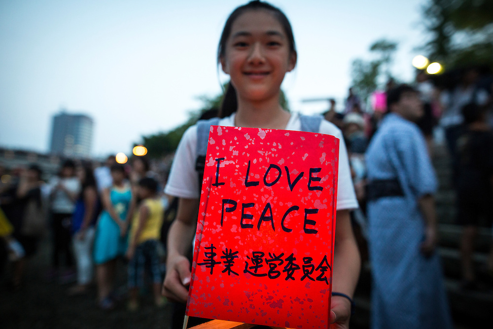 "HIROSHIMA, JAPAN - AUGUST 6 : A student wait to float candle lit lanterns with written message ""I LOVE PEACE"" on the Motoyasu River during the 71st anniversary activities, commemorating the atomic bombing of Hiroshima at the Hiroshima Peace Memorial Park on August 6, 2016 in Hiroshima, western Japan. Japan marks the 71st anniversary of the first atomic bomb that was dropped by the United States on Hiroshima on August 6, 1945 during World War II.  (Photo by Richard Atrero de Guzman/NURPhoto)"