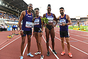 Members of the Americas mixed 4 x 400m relay pose after winning in 3:13.01 during the IAAF Continental Cup 2018 at Mestky Stadion in Ostrava, Czech Republic, Sunday, Sept. 9, 2018. From left: Christian Taylor (USA), Stephenie Ann McPherson (JAM), Shaunae Miller-Uibo (BAH) and Luguelin Santos (PUR). (Jiro Mochizuki/Image of Sport)