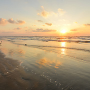 Sun is rising over Texas Coast in Port Aransas.