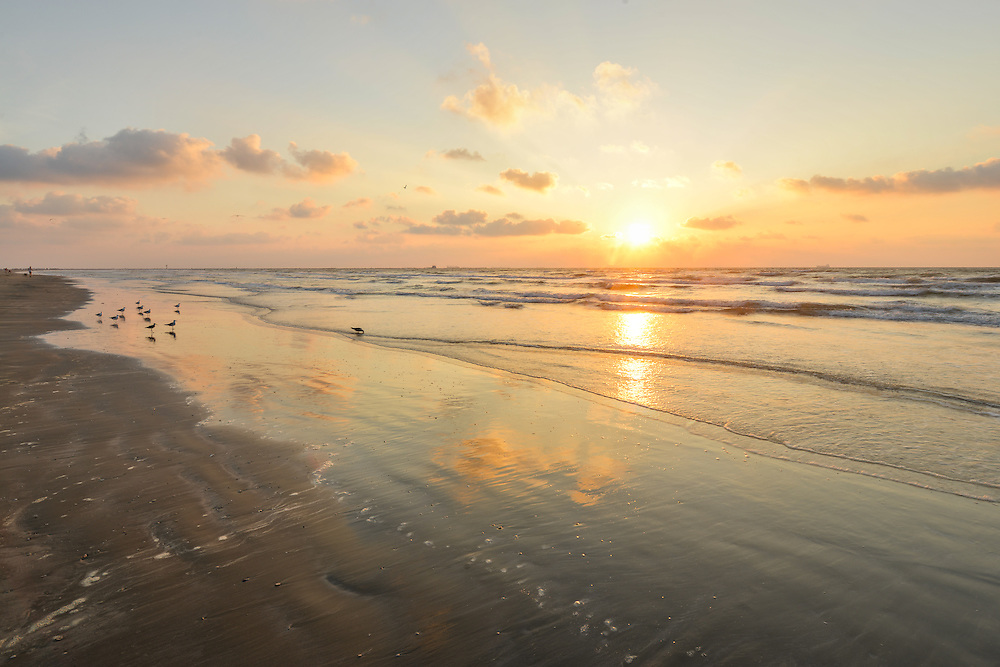 Sun is rising over Texas Coast in Port Aransas.