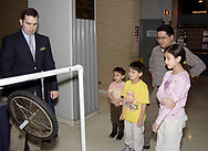 Volunteer Brett Sammis (left,) from Hamilton, demonstrates the Gyroscopic Wheel to the Leembruggen family during Family Day at the National Museum of the U.S. Air Force, Saturday, January 20, 2007.  (front row, left to right is Jameson, 5; Nathaniel, 7 and Madelyn, 11) Oliver Leembruggen, from Beavercreek, is behind them.
