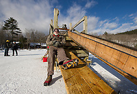 Bruce Whitmore takomg a rest on the upload ramp while waiting for a truck to load during the annual Rockywald/Deephaven Camp's ice harvest on Wednesday.  (Karen Bobotas/for the Laconia Daily Sun)