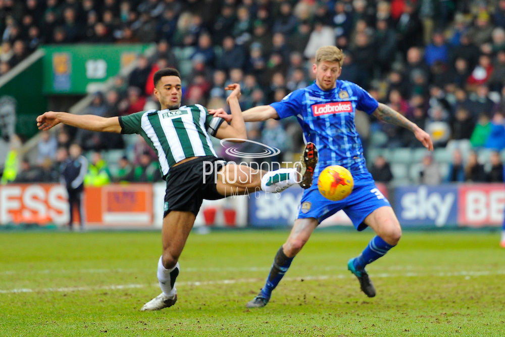 Plymouth Argyle's Curtis Nelson and Notts County's Jonathan Stead during the Sky Bet League 2 match between Plymouth Argyle and Notts County at Home Park, Plymouth, England on 27 February 2016. Photo by Graham Hunt.