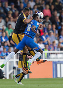 Rakish Bingham (Hartlepool United) wins the high ball under pressure from Leon Legge (Cambridge United) during the Sky Bet League 2 match between Hartlepool United and Cambridge United at Victoria Park, Hartlepool, England on 19 September 2015. Photo by George Ledger.