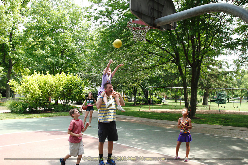 Lauren, 5 takes a shot sitting on father Christian Taylor's shoulders as (from left) son Bryce, 8 and friends Sammi Buschur, 15 and Jas Buschur look on at Shafor Park in Oakwood, Sunday, June 9, 2013.