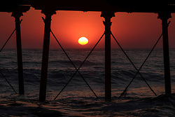 © Licensed to London News Pictures. <br /> 09/05/2016. <br /> Saltburn by the Sea, UK.  <br /> <br /> The rising sun is seen through the legs of the pier at Saltburn by the Sea in North Yorkshire. After the warmest day of the year yesterday temperatures are due to drop slowly over the rest of the week.<br /> <br /> Photo credit: Ian Forsyth/LNP