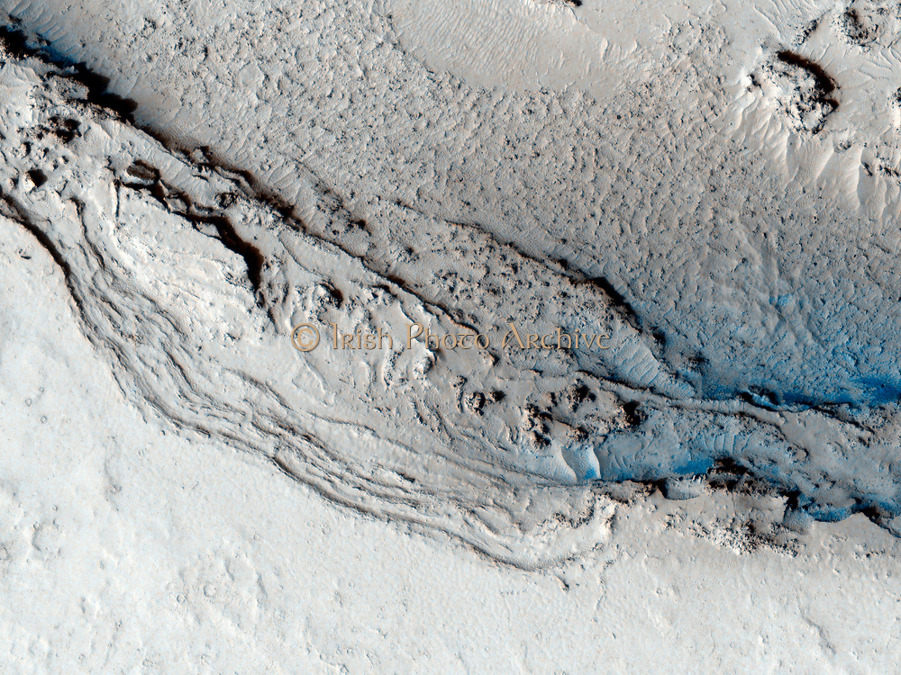 This image hows the funnel-shaped terminus of Lethe Vallis, a winding channel in the Elysium Planitia region of Mars. MRO.