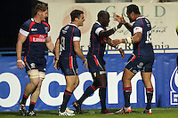 Takudzwa Ngwenya of USA celebrates after scoring during their  rugby test match against Romania, on National Stadium Arc de Triomphe in Bucharest, November 8, 2014.