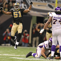 Jan 24, 2010; New Orleans, LA, USA; New Orleans Saints linebacker Jonathan Vilma (51) celebrates after cornerback Tracy Porter (22) intercepted a pass against the Minnesota Vikings during the fourth quarter of the 2010 NFC Championship game at the Louisiana Superdome. Mandatory Credit: Derick E. Hingle-US PRESSWIRE