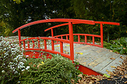 Red bridge in an Urban park in Paris, France