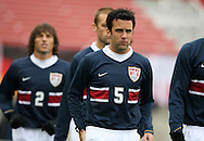 Kerry Zavagnin (5), of the United States, is followed by teammates Jimmy Conrad and Frankie Hejduk (2) as the enter the field before the game on Sunday, February 19th, 2005 at Pizza Hut Park in Frisco, Texas. The United States Men's National Team defeated Guatemala 4-0 in a men's international friendly.