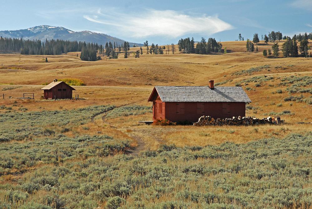 Late morning sunlight illuminates a ranger cabin near Blacktail Creek Trailhead in Yellowstone National Park.