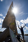 Men on sailboat, dhow, off Lamu Island, Kenya, Africa