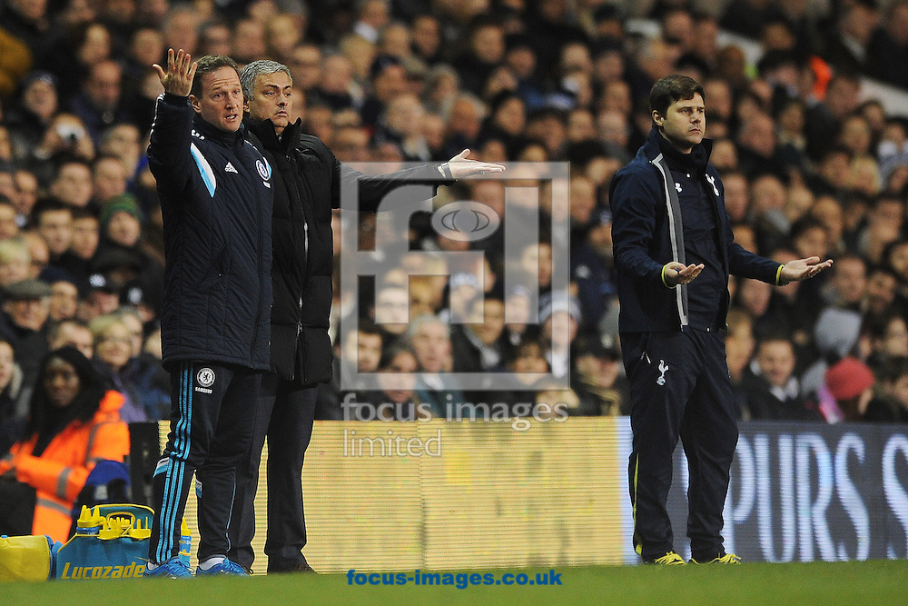 Chelsea Manager Jose Mourinho and his Assistant Steve Holland demonstrate from the touchline during the Barclays Premier League match between Tottenham Hotspur and Chelsea  at White Hart Lane, London<br /> Picture by Richard Blaxall/Focus Images Ltd +44 7853 364624<br /> 01/01/2015