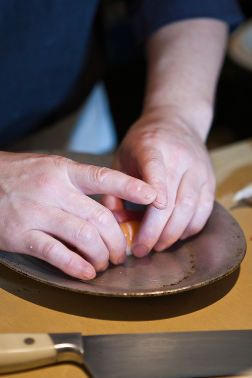 Chef Noriaki Yasutake carefully forms perfect salmon sushi at Sei.