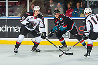 KELOWNA, BC - OCTOBER 03:  Leif Mattson #28 of the Kelowna Rockets stick checks Milos Roman #40 of the Vancouver Giants as he looks for the pass at Prospera Place on October 3, 2018 in Kelowna, Canada. (Photo by Marissa Baecker/Getty Images)