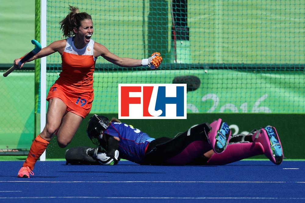 RIO DE JANEIRO, BRAZIL - AUGUST 17:  Ellen Hoog #19 of Netherlands celebrates after scoring the game winning goal on goalie Kristina Reynolds #32 of Germany in a sudden death shootout during the women's semifinal match between the Netherlands and Germany on Day 12 of the Rio 2016 Olympic Games at the Olympic Hockey Centre on August 17, 2016 in Rio de Janeiro, Brazil.  (Photo by Rob Carr/Getty Images)