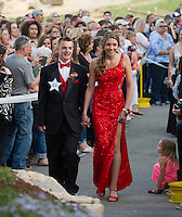 Kyle Chaisson escorts his date Hailey Thayer through the march for Laconia High School's Junior Prom at Gunstock on Friday evening.  (Karen Bobotas/for the Laconia Daily Sun)