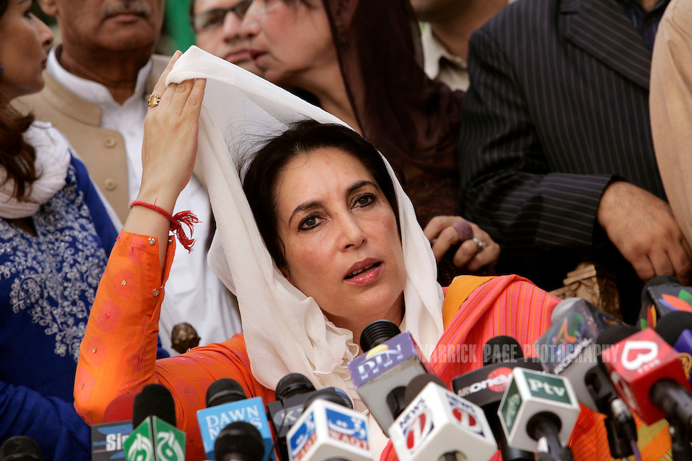 LAHORE, PAKISTAN - NOVEMBER 16: Former prime minister, Benazir Bhutto speaks to media outside her residence on November 16, 2007, in Lahore, Pakistan. The government placed Bhutto under house arrest on Tuesday to prevent a mass-rally taking place from Lahore to Islamabad. (Photo by Warrick Page)