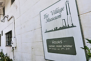 Sign marking the Village Museum in the tiny hamlet of McClellanville, South Carolina. McClellanville is a tiny fishing village inside the Cape Romain National Wildlife Refuge and surrounded by Francis Marion National Forest.