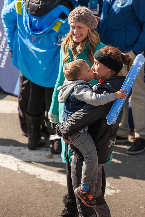NYC Marathon, Kara Goucher hold son Colt after race
