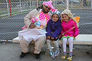 Oct. 25, 2013 - Bronx, NY. A baby (Angel Vargas, 33) waits with Frankie Stein (Sky, 6) and Tinker Bell (Stacey, 5) for the 28th Annual South Bronx Halloween Parade in Hunts Point. 10/25/2013 Photo by Nicholas Wells / CUNY Photo Wire