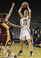 February 18, 2010: Iowa forward Kelsey Cermak (22) passes the ball during the second half of the NCAA women's basketball game at Carver-Hawkeye Arena in Iowa City, Iowa on February 18, 2010. Iowa defeated Minnesota 75-54.
