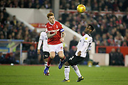 Nottingham Forest midfielder Jack Colback (6) beats Derby County midfielder Florian Jozefzoon (11) to the ball during the EFL Sky Bet Championship match between Nottingham Forest and Derby County at the City Ground, Nottingham, England on 25 February 2019.