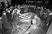 08/02/1963<br /> 02/08/1963<br /> 08 February 1963<br /> New Esso sign being erected at O'Connell Street Dublin. Workmen prepare the ropes to support the sign during it's erection watched by curious passers by.