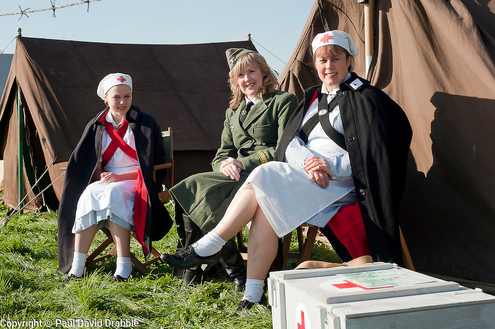 Three Female reenactors portray 2 DRK Deutsche Rote Kreuz (German Red Cross) nurses The third is dressed as a Helferin (Female German  Auxiliary). Living History camp on the Pickering Showground during the  Pickering wartime weekend. 2011.Saturday 15th October 2011. Image © Paul David Drabble