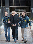 Nov. 12, 2015 - (File Photo) - <br /> A federal jury in New York found alleged former Bonanno crime family captain Vincent Asaro not guilty Thursday of one count of racketeering conspiracy and two extortion-related counts. Asaro was found not guilty Thursday of helping pull off the Lufthansa robbery. PICTURED: Jan. 23, 2014 - New York, New York, U.S. - VINCENT ASARO, an alleged captain in the Bonanno crime family, is led from Federal Plaza as he is charged in connection with the 1978 Lufthansa heist at JFK International Airport; he was arrested for murder, racketeering, extortion, arson, robbery and other charges. <br /> ©Exclusivepix Media