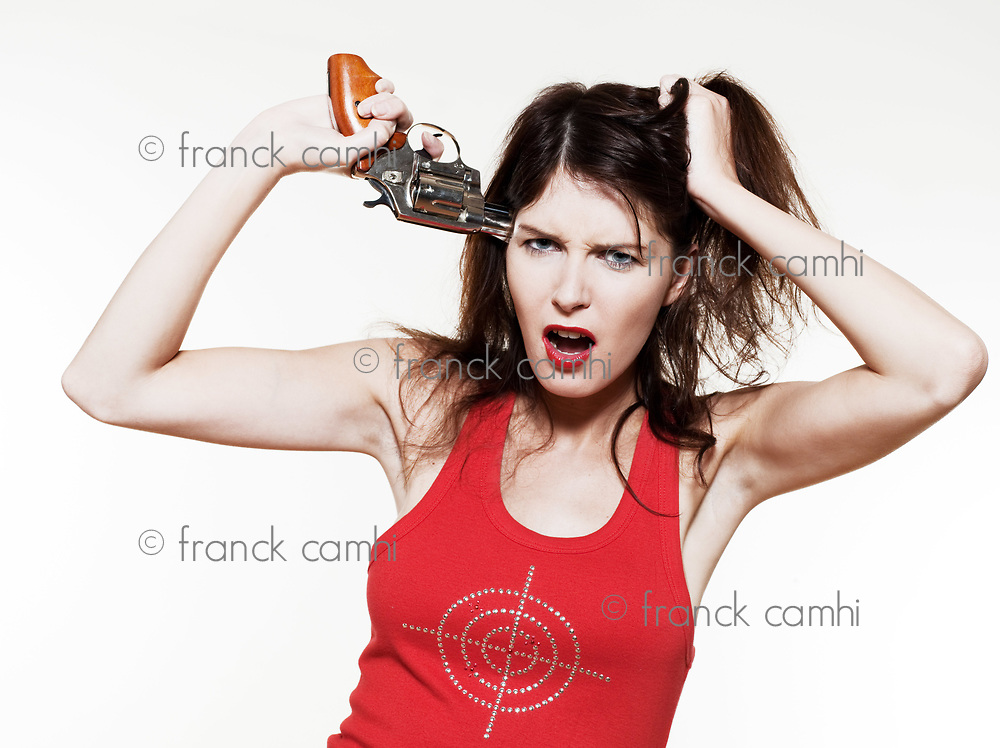 studio portrait of a beautiful woman on isolated on white background of a woman aiming a gun to his head
