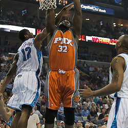 08 April 2009: Phoenix Suns center Shaquille O'Neal (32) dunks over New Orleans Hornets center Hilton Armstrong (12) during a NBA game between the New Orleans Hornets and the Phoenix Suns at the New Orleans Arena in New Orleans, Louisiana.