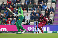 Cricket - 2019 ICC Cricket World Cup - Group Stage: South Africa vs. West Indies<br /> <br /> Chris Gayle of the West Indies takes the catch to dismiss Hashim Amla of South Africa for 6 off the bowling of Sheldon Cottrell of the West Indies during the cricket world cup match at the Hampshire Bowl Southampton England<br /> <br /> COLORSPORT/SHAUN BOGGUST