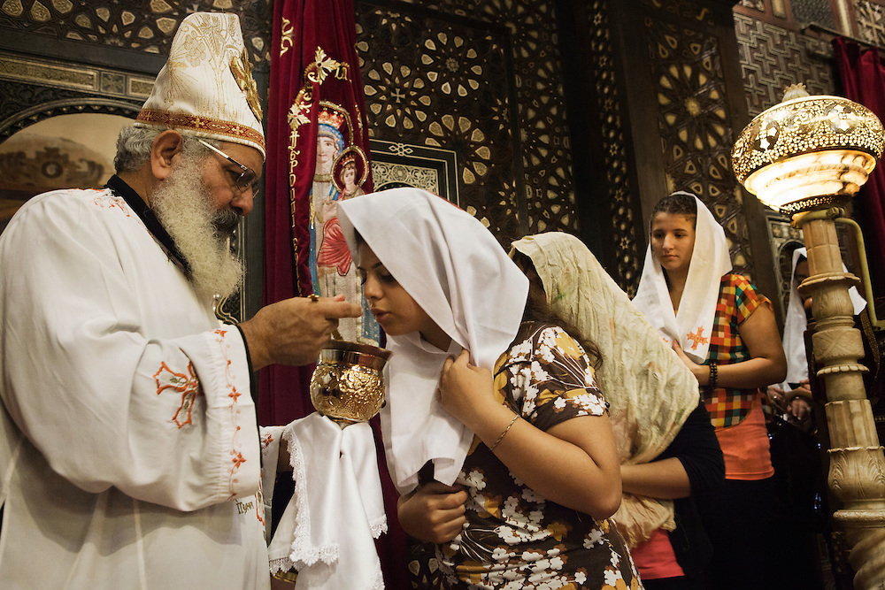 Christians worshippers in the Hanging Church Al Moallaqa in Cairo take part in a ritual during a mass.