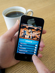 Reading e-book travel guide to Venice on an Apple iphone 4G smartphone