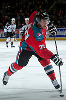 KELOWNA, CANADA - MARCH 15: Myles Bell #29 of the Kelowna Rockets takes a shot on net against the Vancouver Giants during first period on March 15, 2014 at Prospera Place in Kelowna, British Columbia, Canada.   (Photo by Marissa Baecker/Getty Images)  *** Local Caption *** Myles Bell;