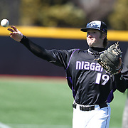 Michael Fuhrman #19 of the Niagara Purple Eagles throws the ball during the game at Friedman Diamond on March 16, 2014 in Brookline, Massachusetts. (Photo by Elan Kawesch)