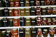 Greece, Thessaly, Makrinitsa on the slopes of mount Pelion jars of home-made Jams lined up on a shelf