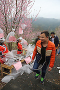 QINGYUAN, CHINA - MARCH 19: (CHINA OUT) <br /> <br /> Visitors purchase clean air in north area of Guangdong Province where mountains surround with clean air on March 19, 2016 in Qingyuan, Guangdong Province of China. Urban citizens in north China\'s Guangdong Province get away from smog-stricken cities to mountain-surrounded north areas and local residents think up an idea of selling clean air that a small bag of air sells 10 yuan and a larger one 30 yuan. The activity seems to be an effective way to promote environmental protect both in urban and rural areas, said a visitor. <br /> ©Exclusivepix Media