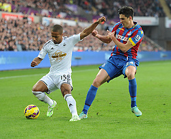 Swansea City's Wayne Routledge battles for the ball with Crystal Palace's Martin Kelly - Photo mandatory by-line: Alex James/JMP - Mobile: 07966 386802 - 29/11/2014 - Sport - Football - Swansea -  - Swansea v Crystal palace  - Barclays Premier League