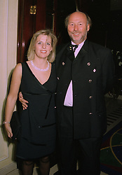 MR CHRIS WRIGHT owner of QPR football club and Wasps rugby club, and MISS JANICE STINNES at a party in London on 9th October 1997.MBZ 38