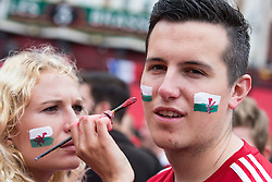 LILLE, FRANCE - Friday, July 1, 2016: A Wales fan has his face painted with the flag of Wales whilst in the centre of Lille ahead of the UEFA Euro 2016 Championship Quarter-Final match against Belgium at the Stade Pierre Mauroy. (Pic by Paul Greenwood/Propaganda)