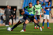 Scott Wagstaff of AFC Wimbledon tackles Ivan Toney of Peterborough United during the EFL Sky Bet League 1 match between Peterborough United and AFC Wimbledon at London Road, Peterborough, England on 28 September 2019.