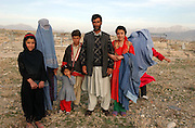 Afghan family on a hilltop overlooking Kabul, Afghanistan. 2002.